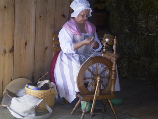 Spinning , notice her wooden shoes
